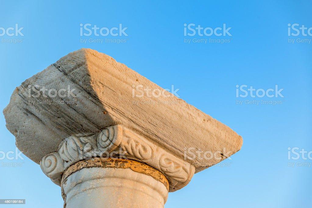 Ionic Greek column with blue sky stock photo