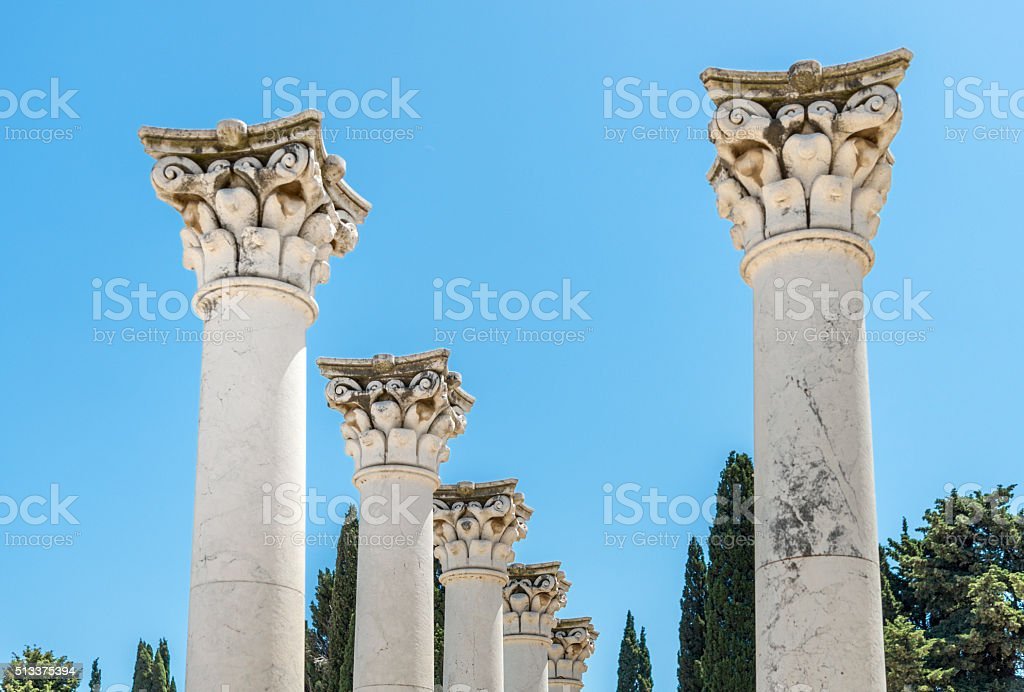 Ionic Greek columns with blue sky stock photo