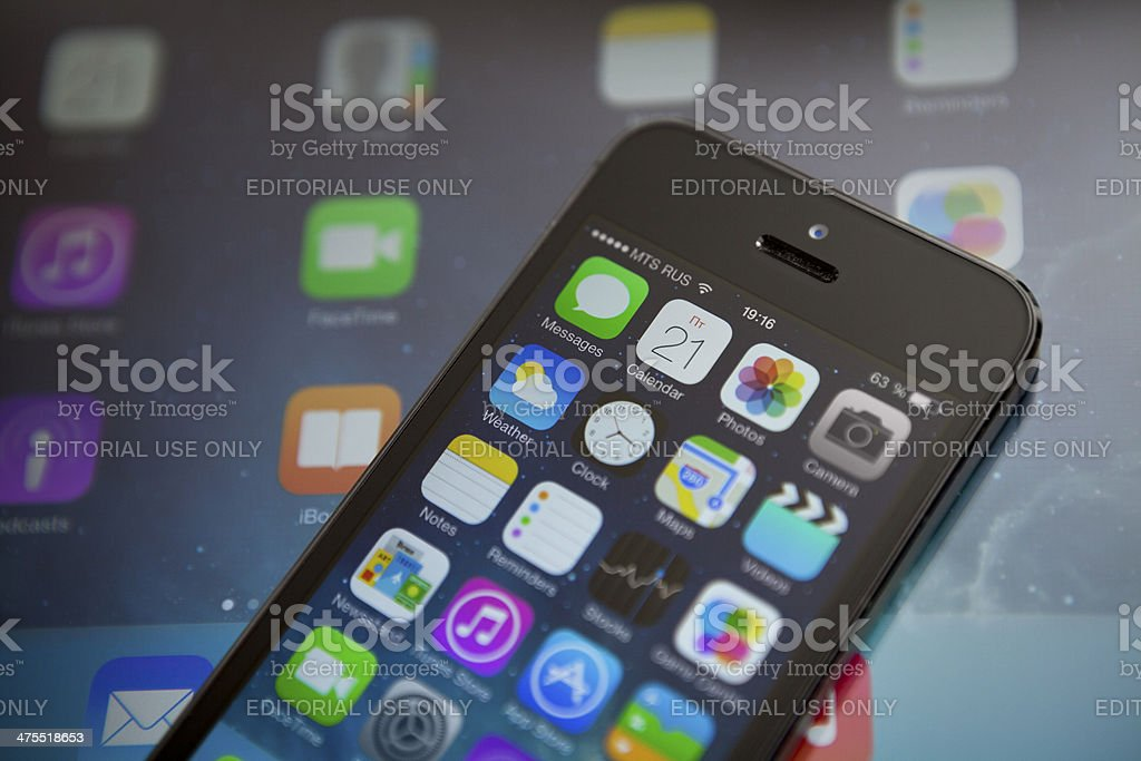 iOS 7 on iPhone and iPad royalty-free stock photo