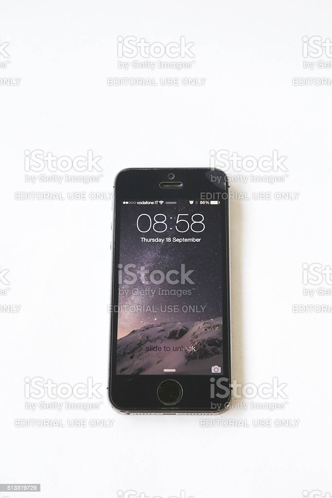 iOS 8 lock screen on iPhone 5s royalty-free stock photo