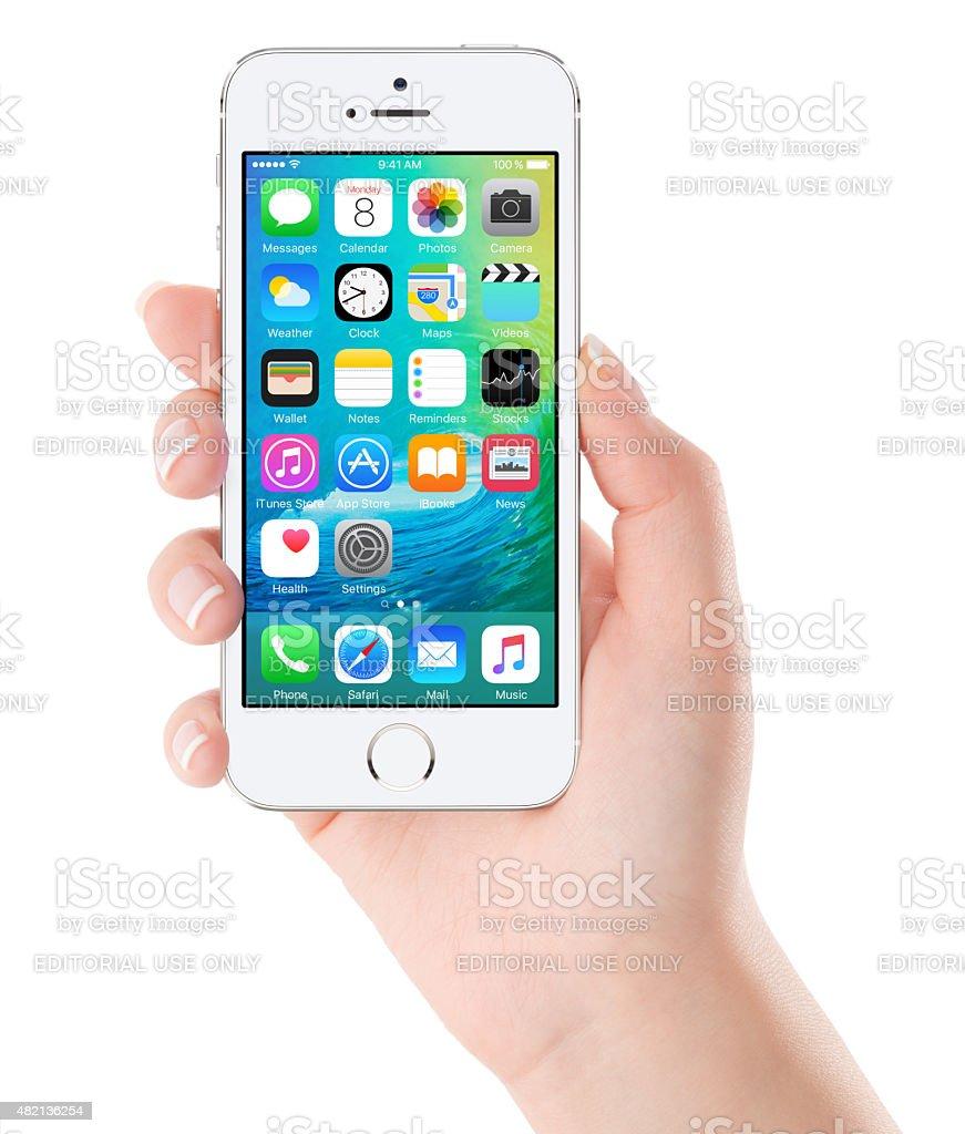 iOS 9 homescreen on the white Apple iPhone 5s display stock photo