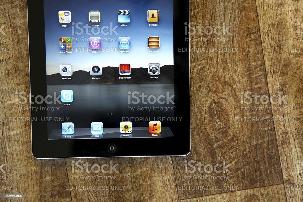 iPad 2 on wooden floor royalty-free stock photo