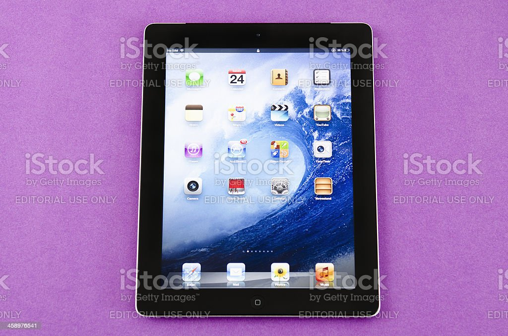 Ipad 3 in a purple background royalty-free stock photo