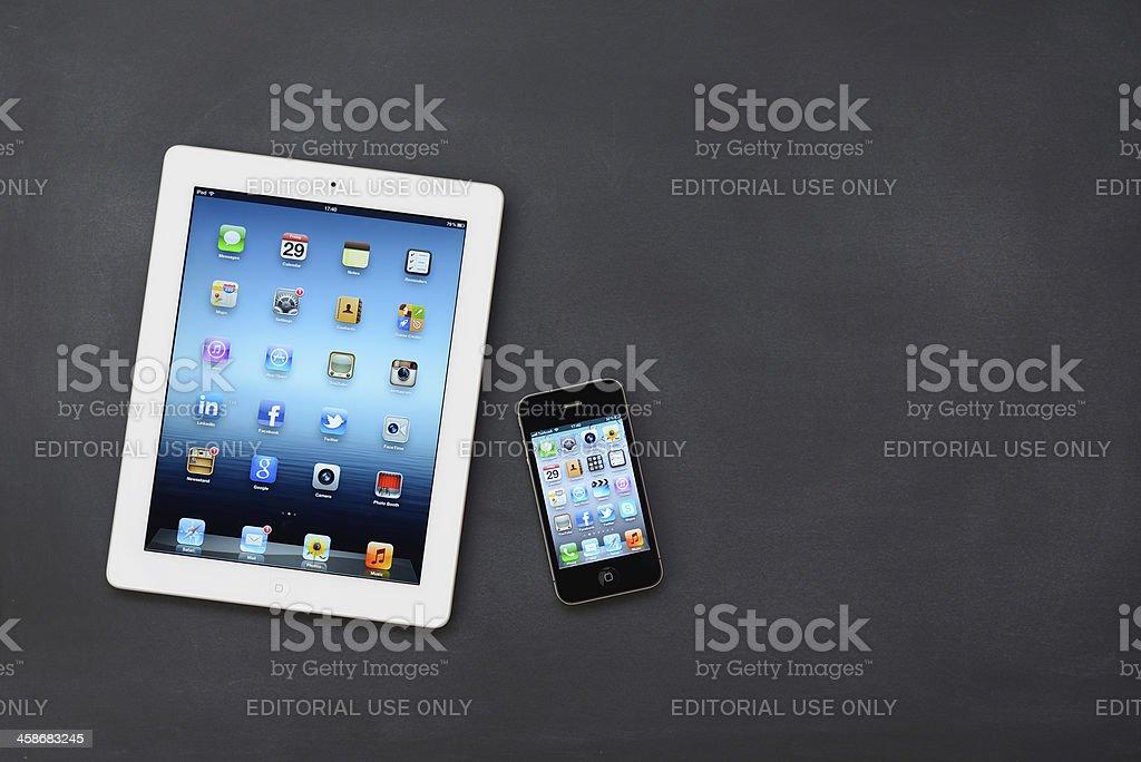 iPad 3 & iPhone 4 on blackboard royalty-free stock photo
