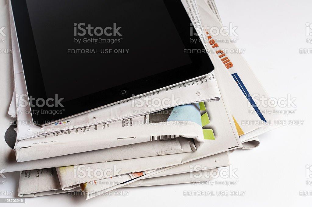 iPad 3 with newspapers stock photo