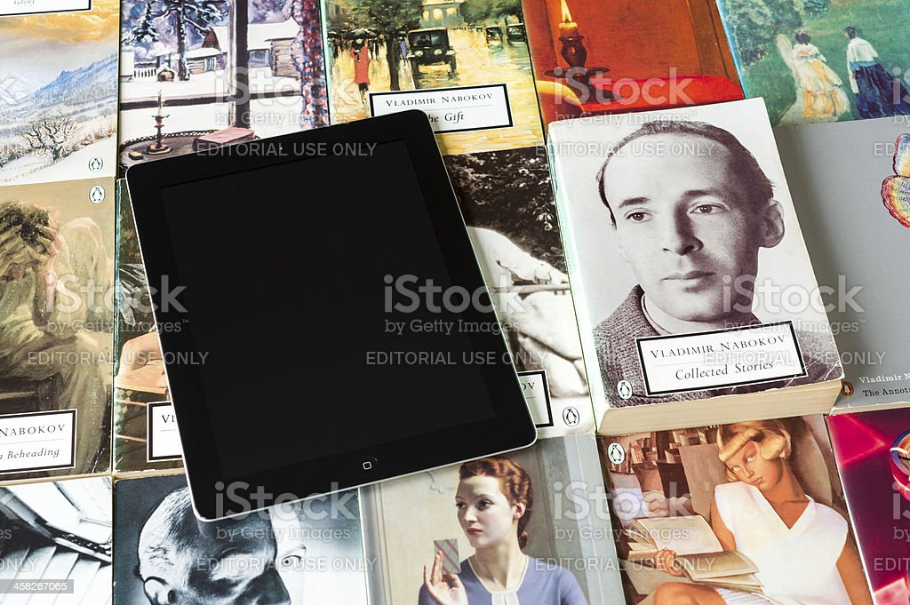 iPad and collection of paperbacks royalty-free stock photo