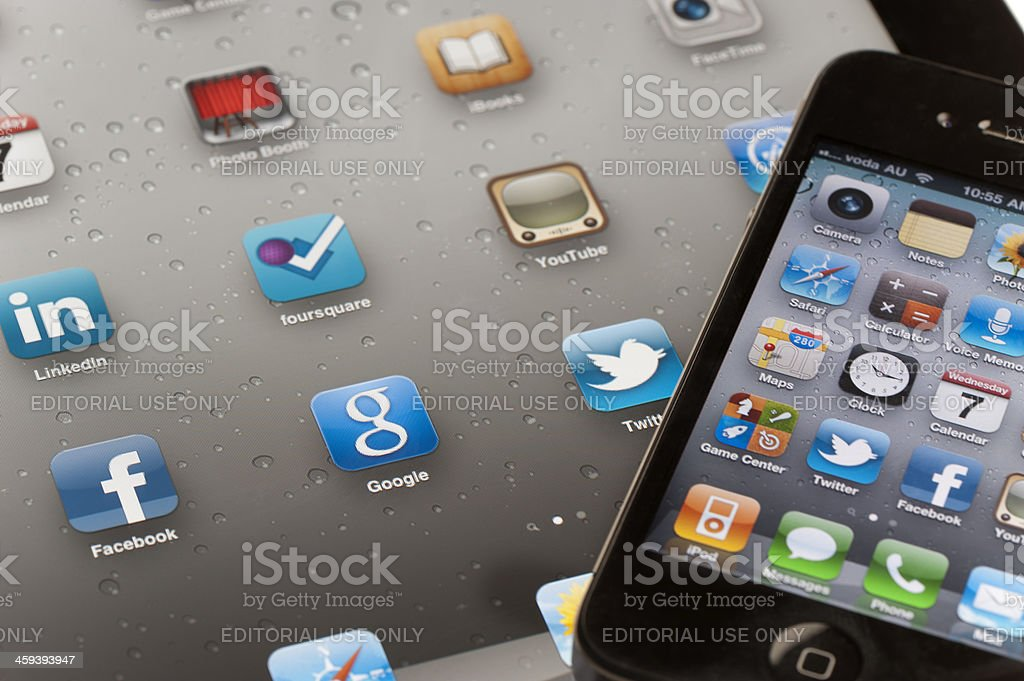 IPad and Iphone both showing home screens stock photo
