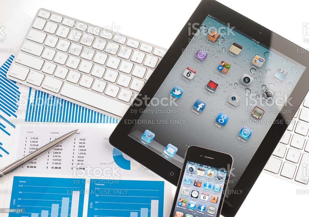 Ipad and iphone on a desk stock photo