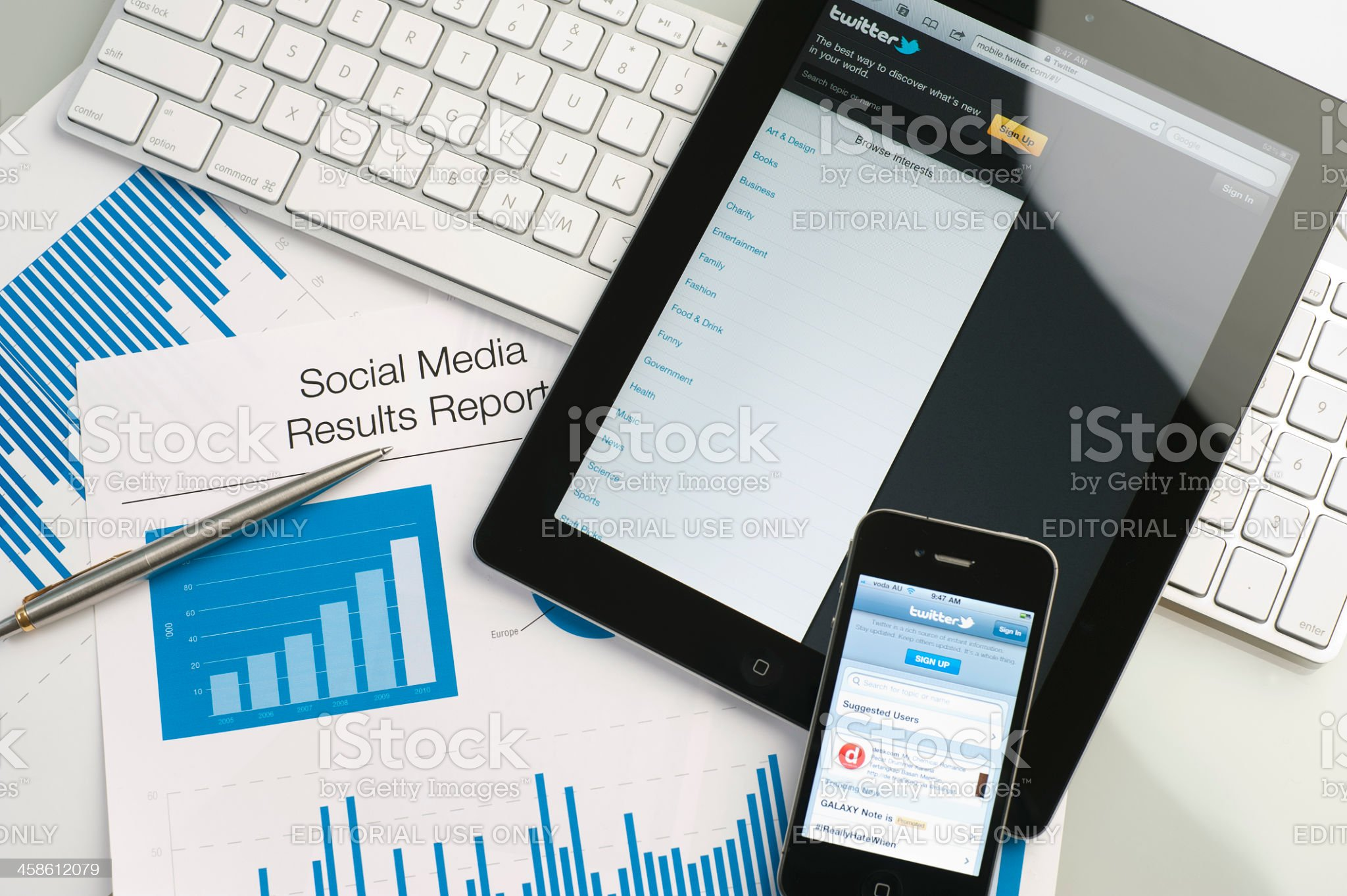 Ipad and iphone on a desk showing twitter royalty-free stock photo