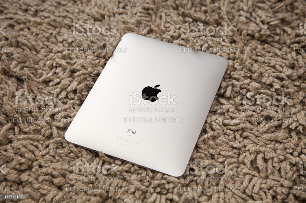 iPad back on woolen rug royalty-free stock photo