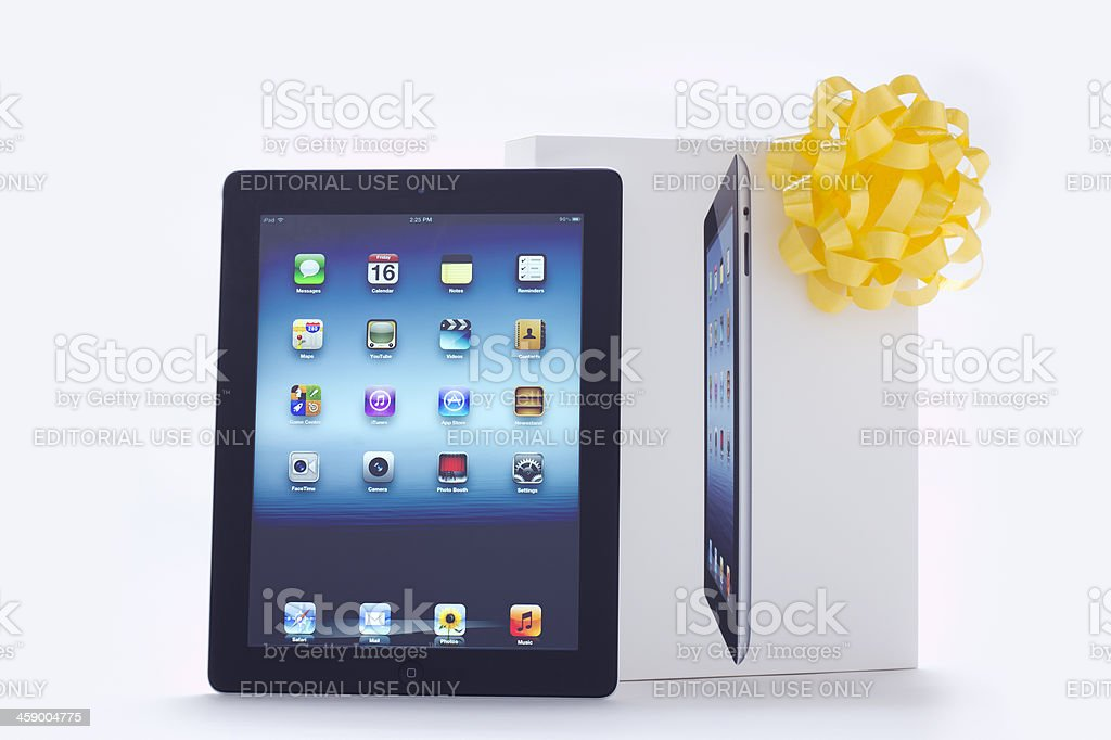 iPad III with Yellow Bow royalty-free stock photo