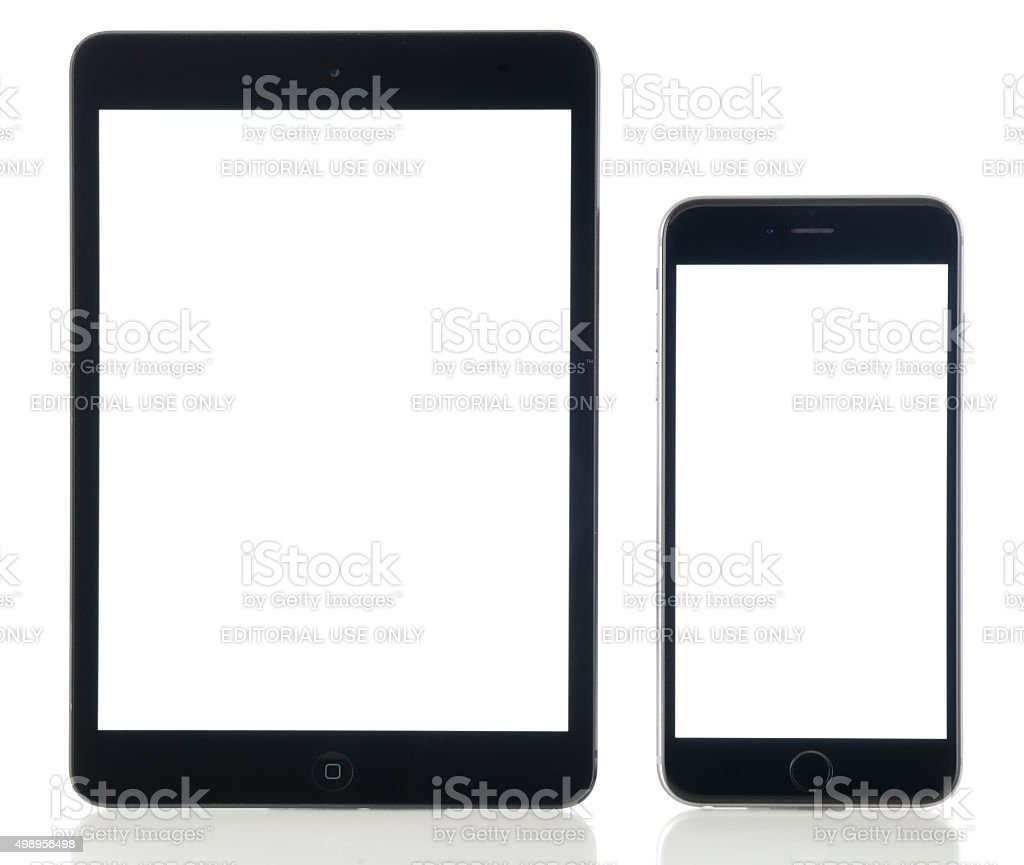 iPad Mini and iPhone 6 Plus blank white screen stock photo