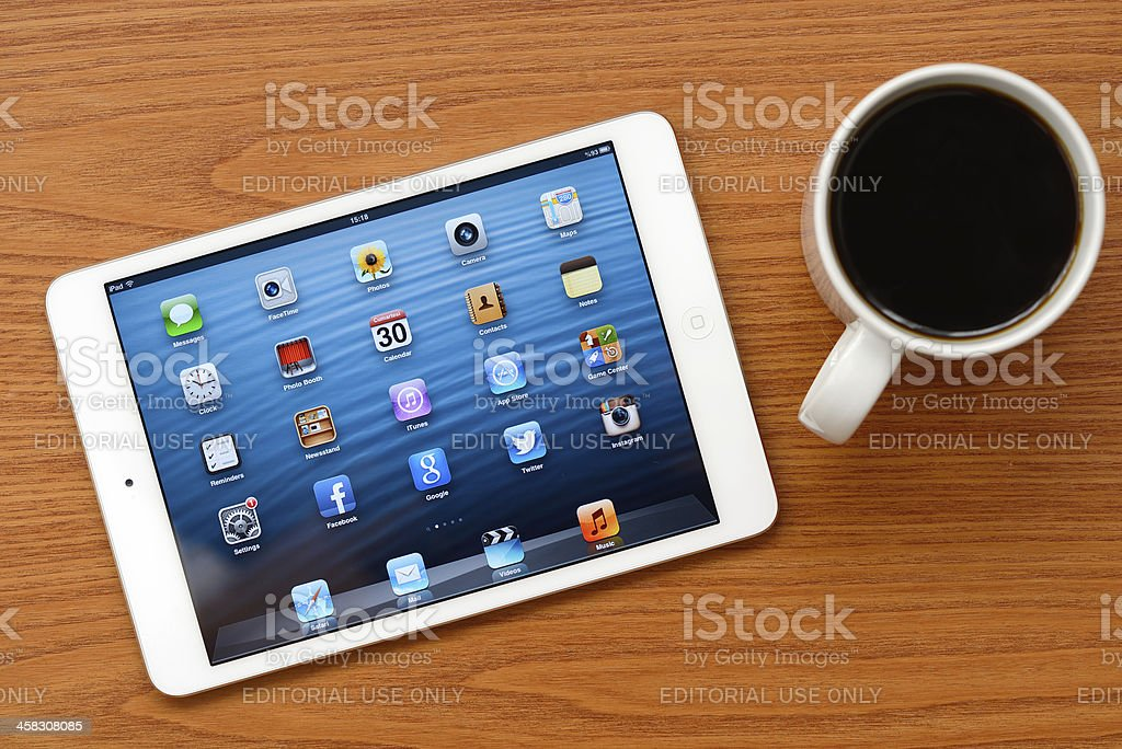 iPad Mini white on office desk royalty-free stock photo