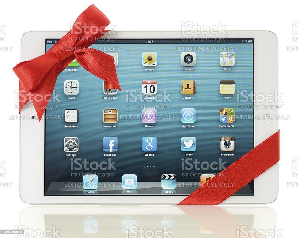 iPad Mini with red ribbon royalty-free stock photo
