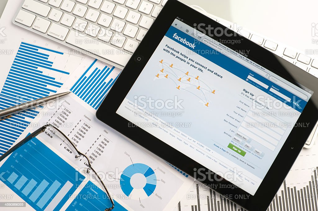Ipad on a desk showing facebook royalty-free stock photo