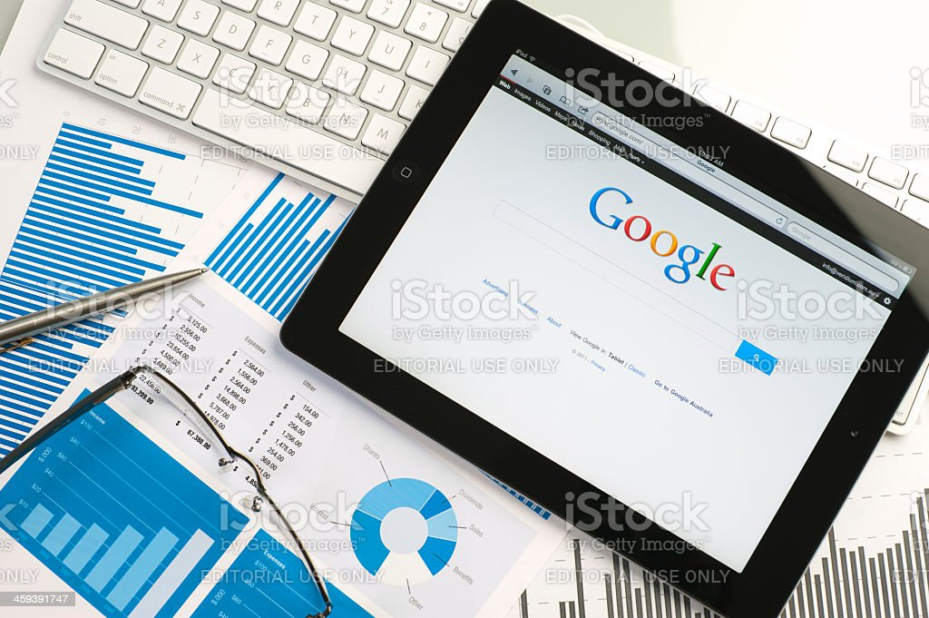 Ipad on a desk showing google stock photo