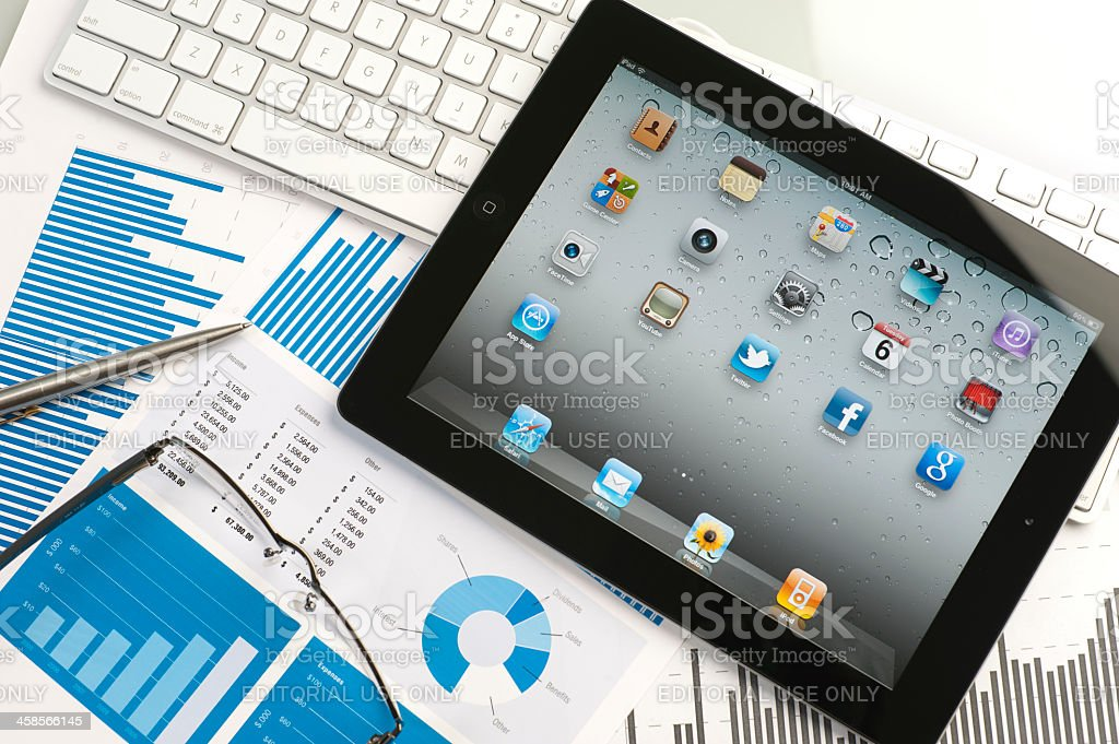Ipad on a desk showing home screen royalty-free stock photo