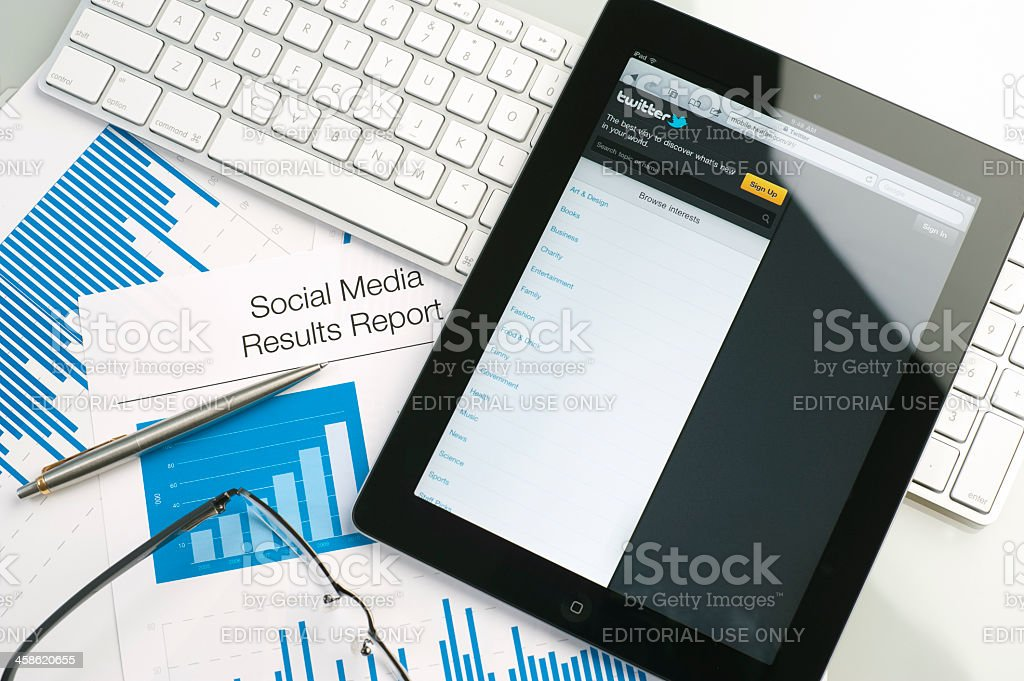 Ipad on a desk showing Twitter stock photo