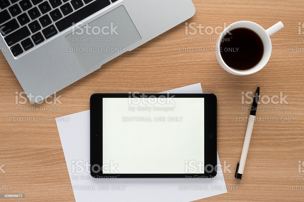 iPad on a desk showing white screen stock photo