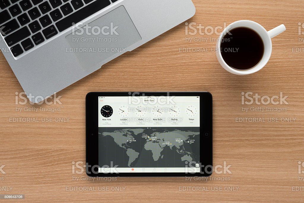 iPad on a desk showing world time stock photo
