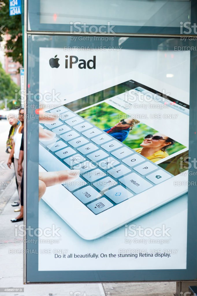 iPad Poster on Bus Stop royalty-free stock photo