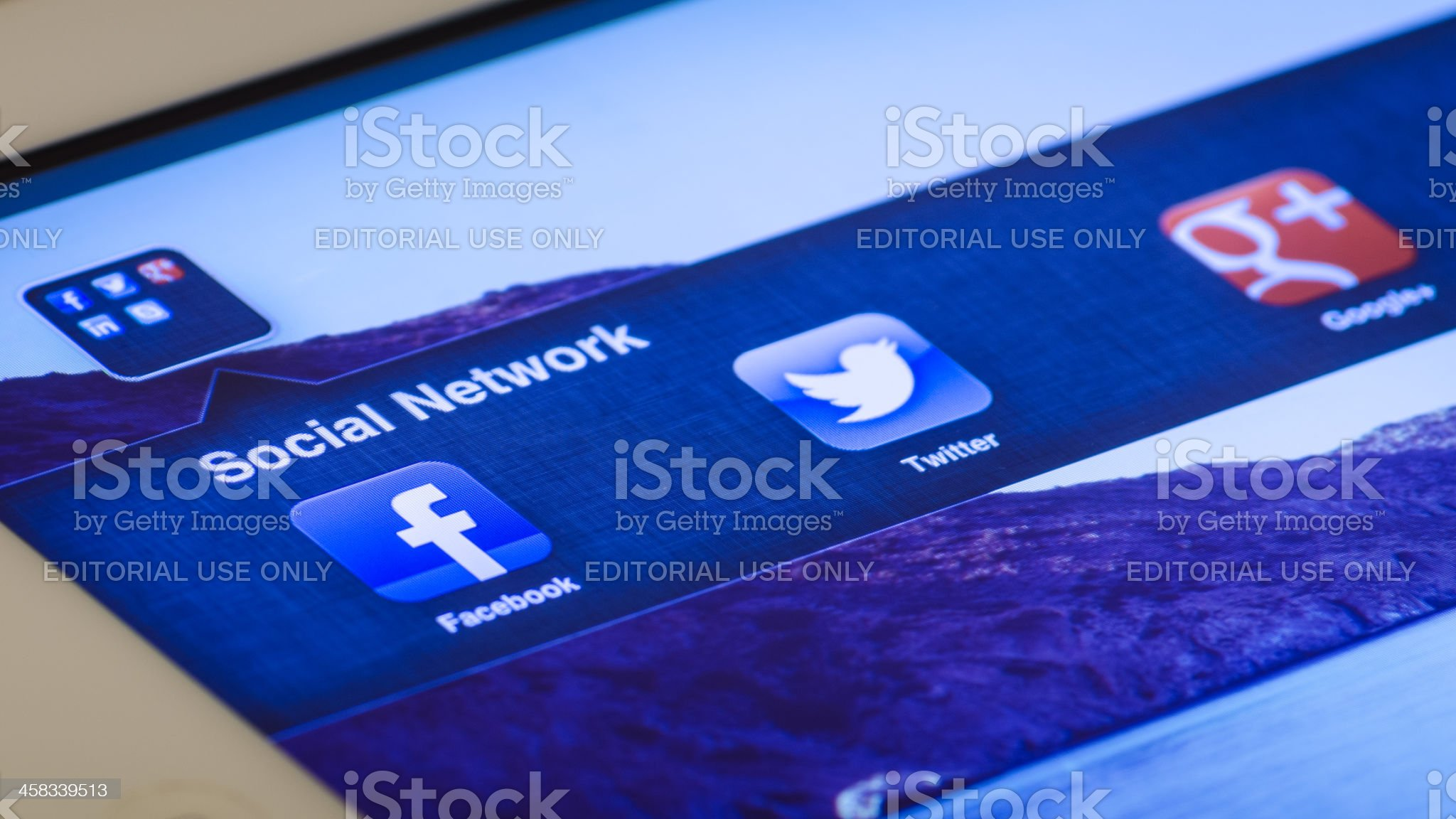 iPad screen shows three famous social network royalty-free stock photo