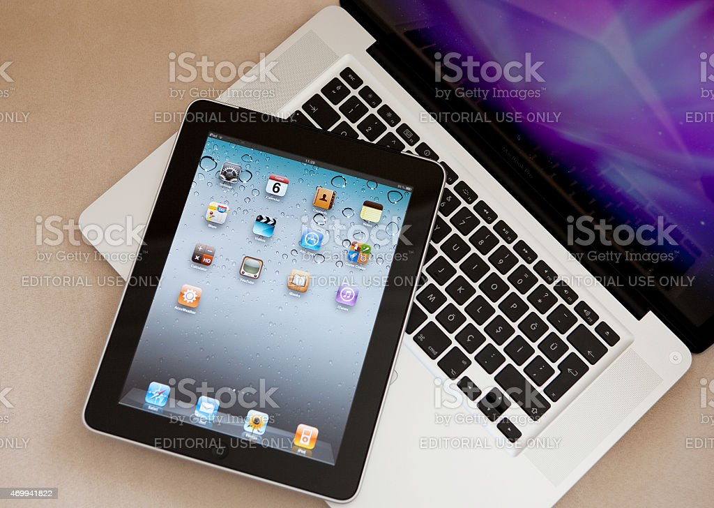 iPad standing on an Apple MacBook Pro stock photo
