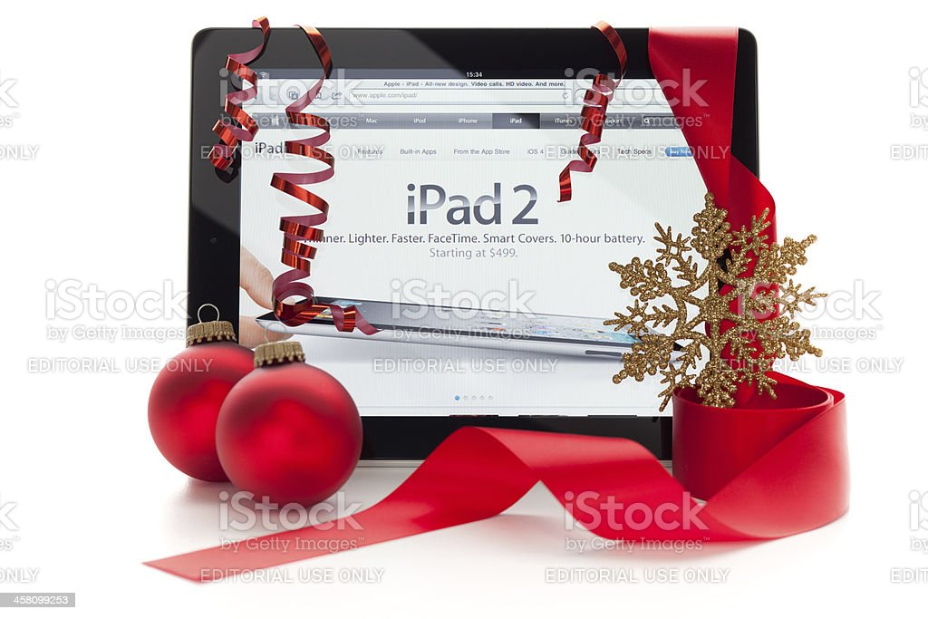 iPad with christmas ornaments and clipping paths. royalty-free stock photo