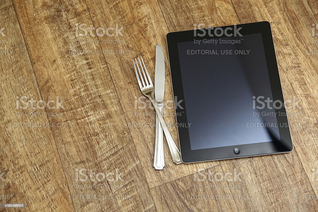 iPad with cutlery royalty-free stock photo