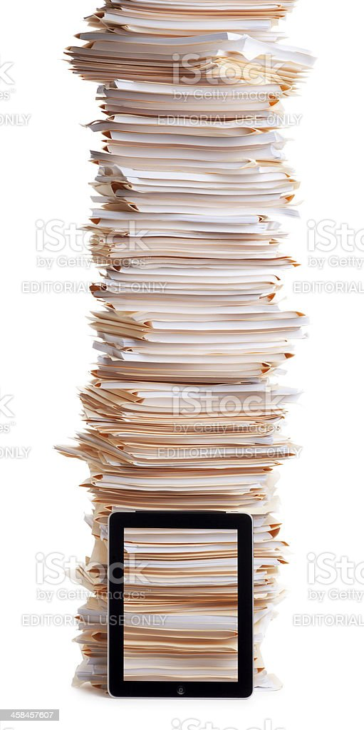 iPad with Stack of Work Files royalty-free stock photo