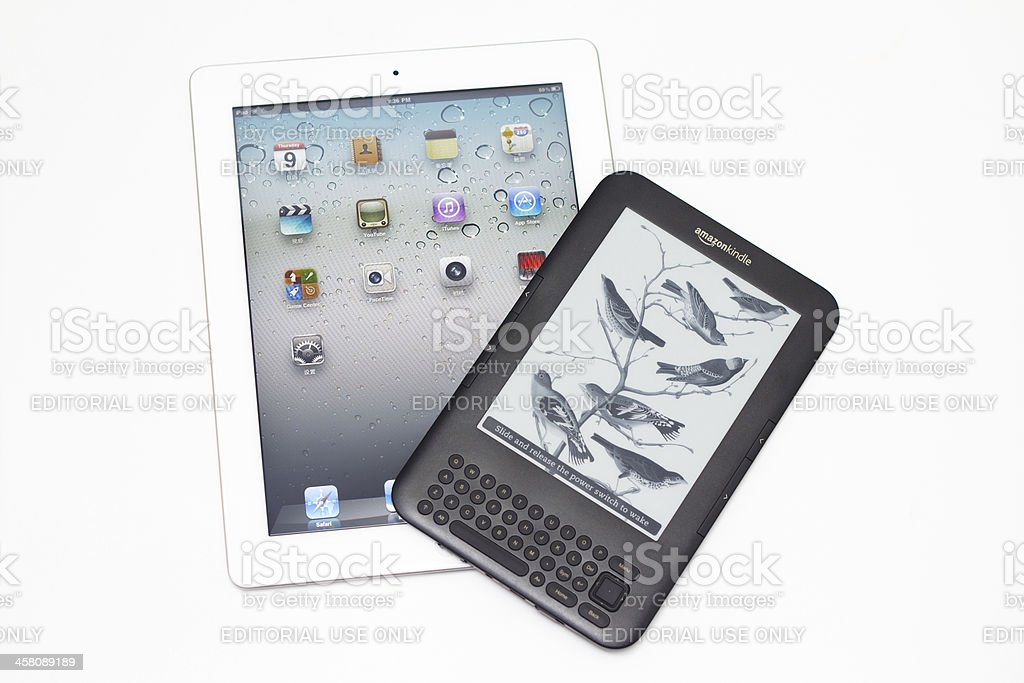 ipad2 VS Kindle3 royalty-free stock photo
