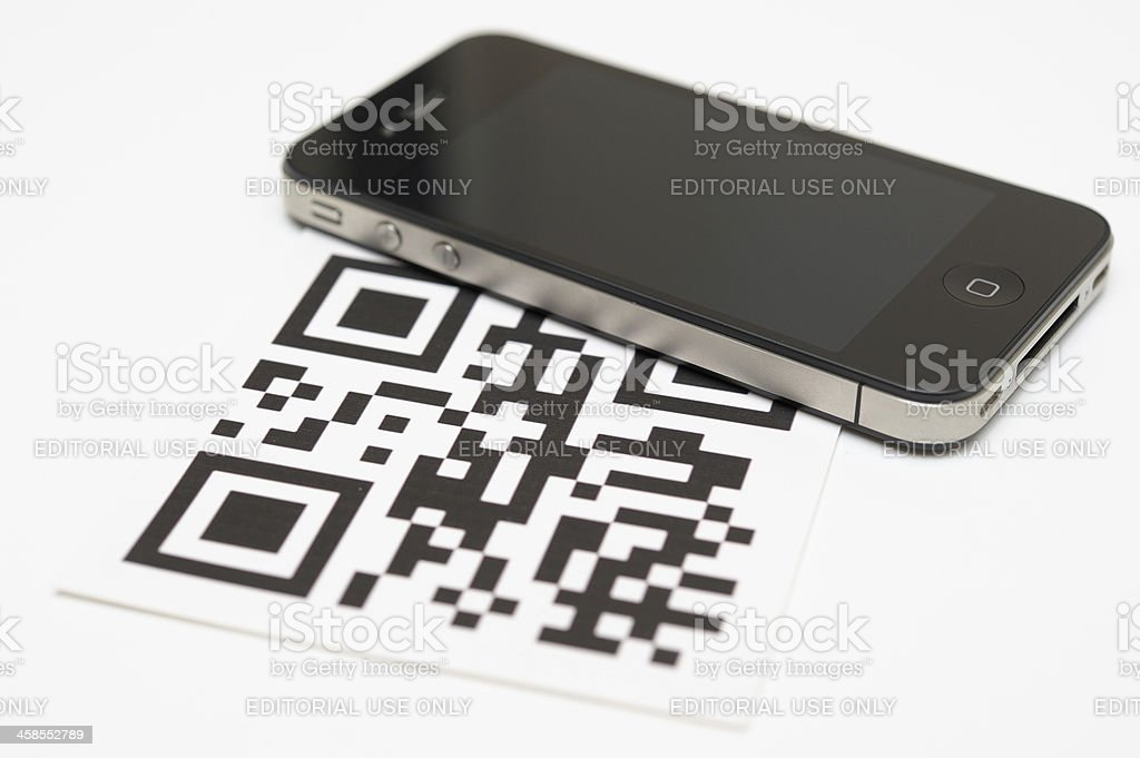 iPhone 4 and QR Code stock photo