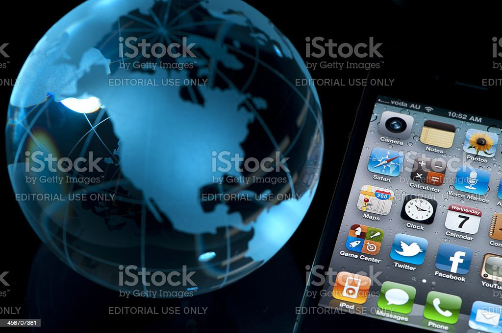 Iphone 4 with a world globe royalty-free stock photo