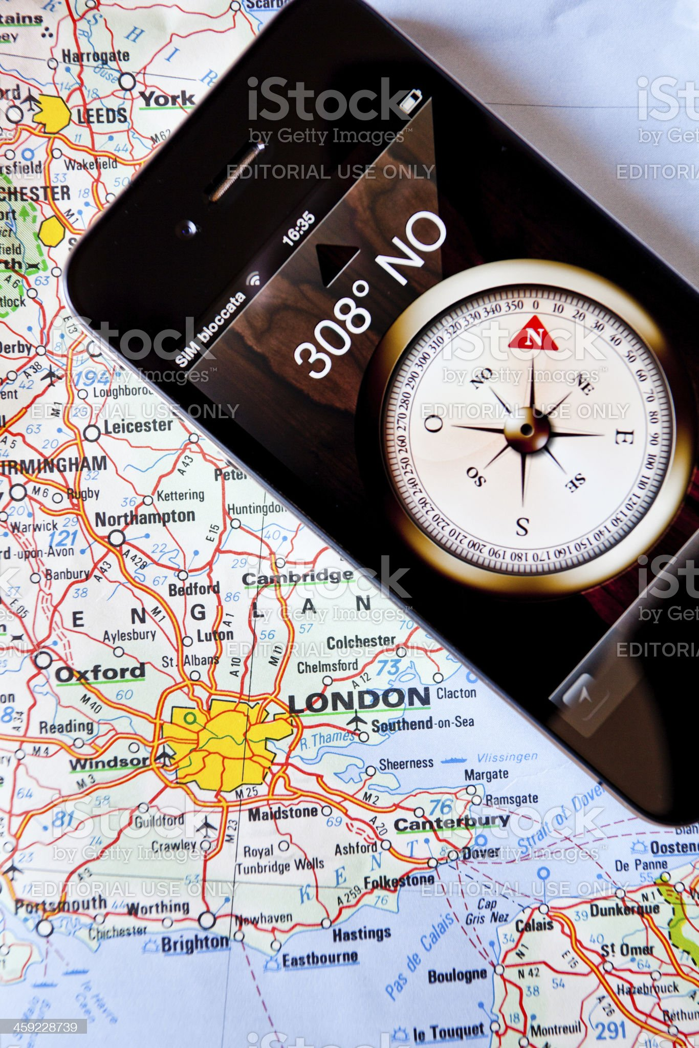 Iphone 4 with Compass on a Map of England royalty-free stock photo