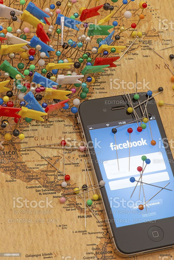 Iphone 4 with Facebook application on map of USA. royalty-free stock photo