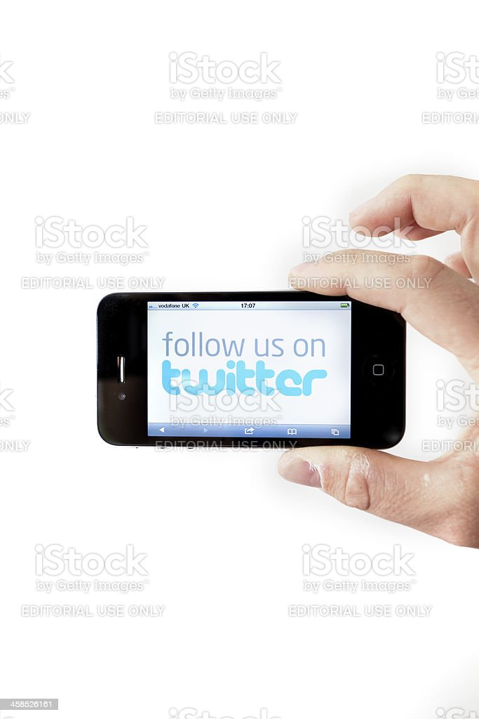 Iphone 4 with Twitter Follow Us Page stock photo