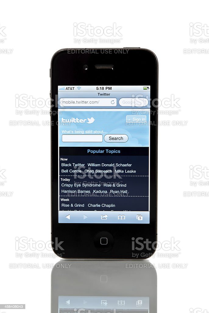 iPhone 4 with Twitter on screen. royalty-free stock photo