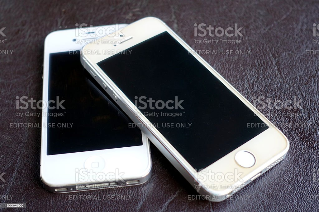 iPhone 4s and iPhone 5s  on table stock photo