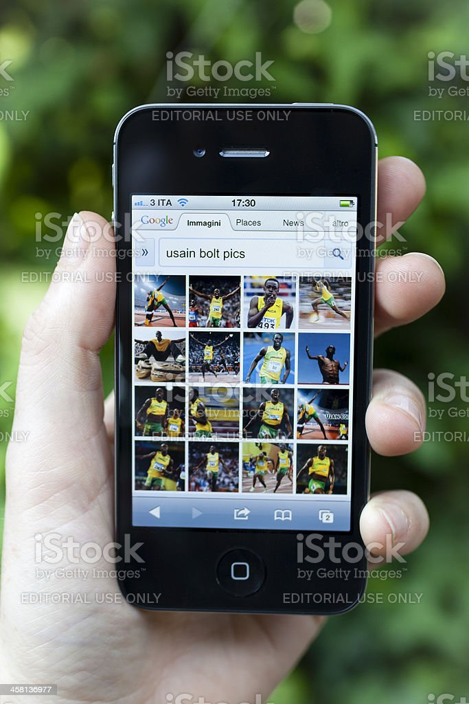 Iphone 4S Displays Usain Bolt with Google Image stock photo