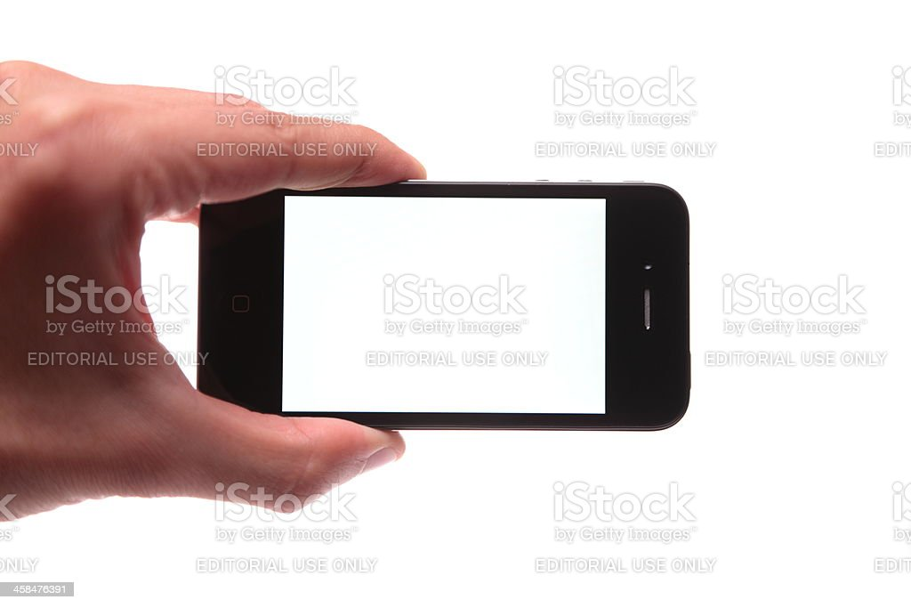 iPhone 4th generation in human hand royalty-free stock photo
