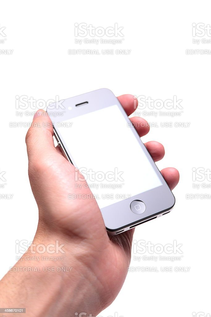 iPhone 4th generation in human hand stock photo