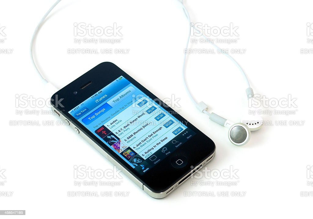 Iphone 4th with Itunes on the screen royalty-free stock photo
