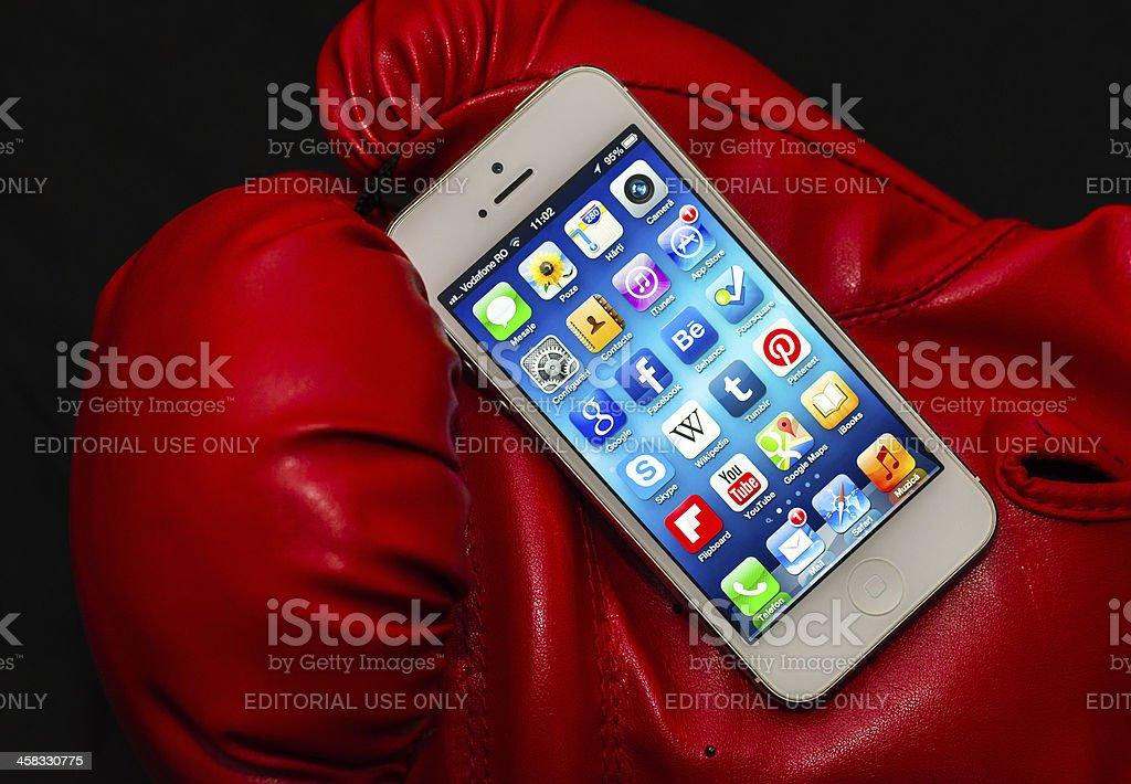 iPhone 5 Apps illuminated screen in a red box glove royalty-free stock photo