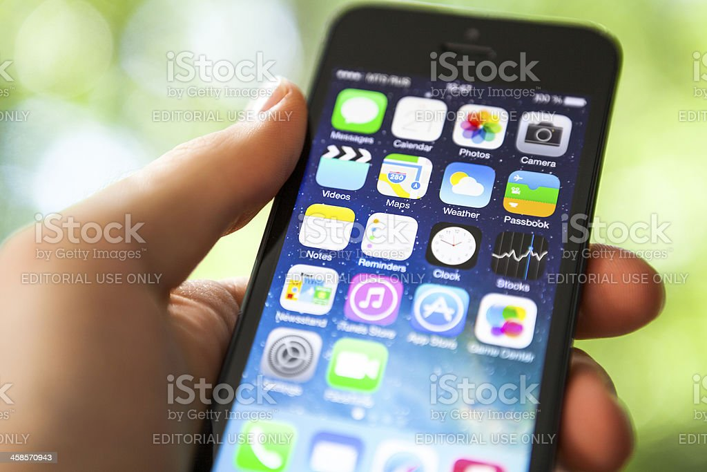iPhone 5 with iOS 7 beta homescreen royalty-free stock photo