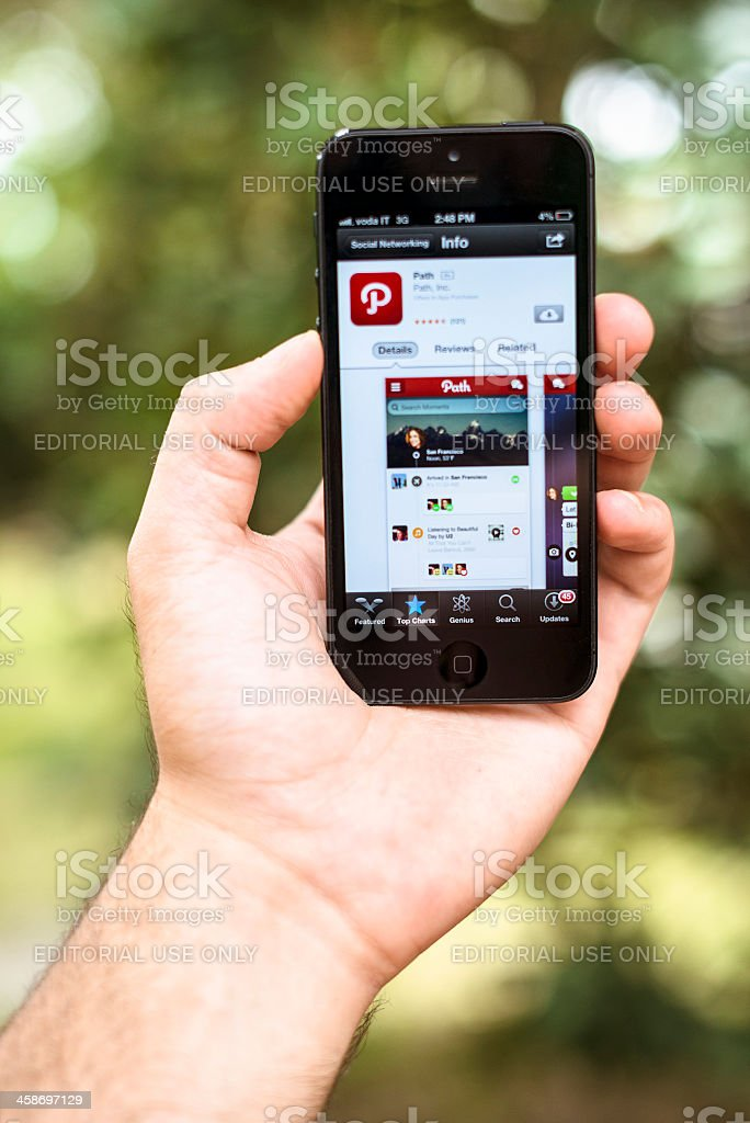 Iphone 5 with Path app on applestore royalty-free stock photo