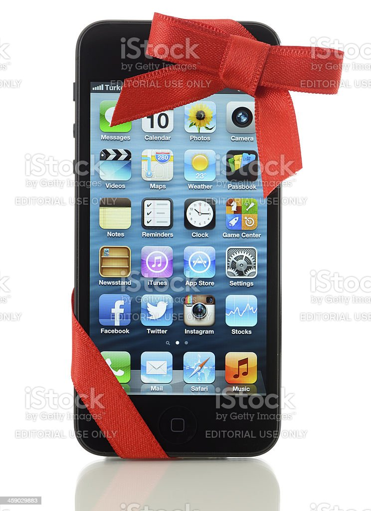 iPhone 5 with red ribbon royalty-free stock photo