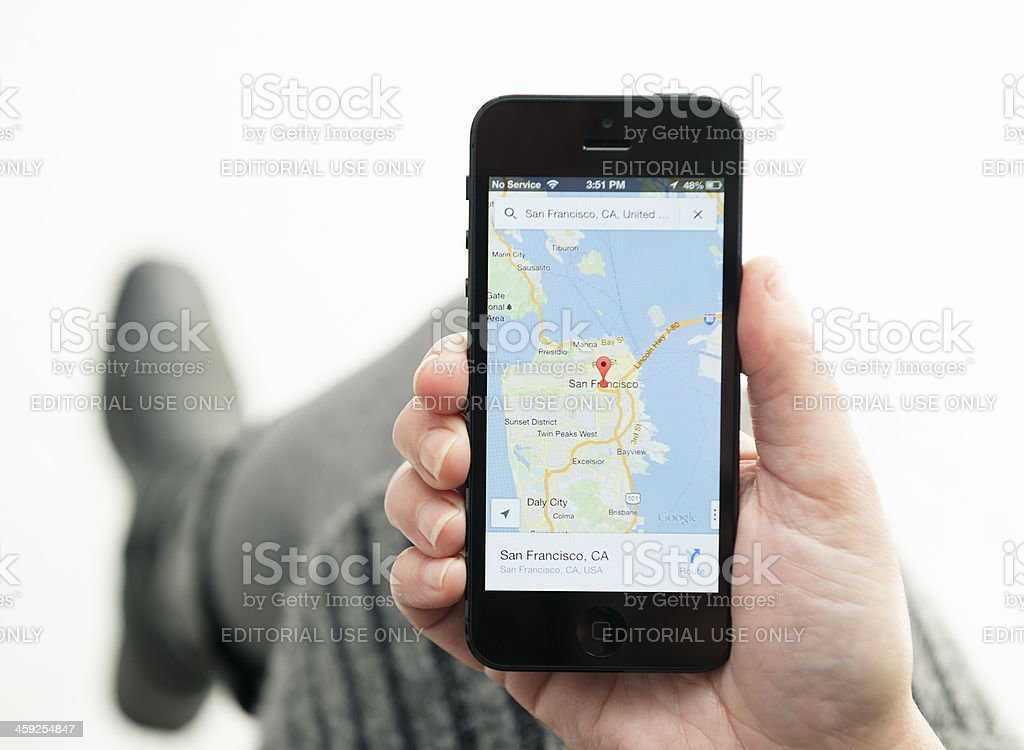 Iphone 5 with the new Google maps app stock photo
