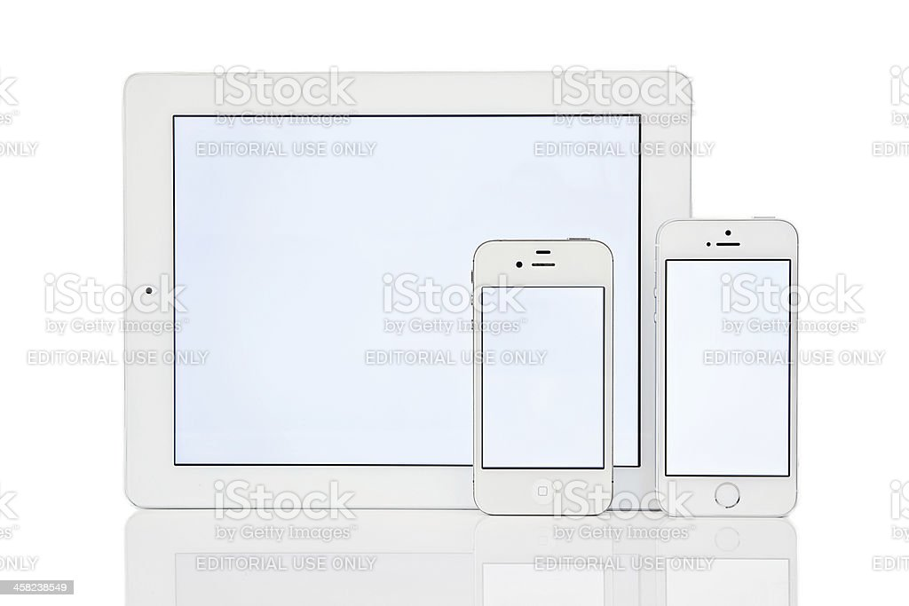 iPhone 5s, 4s and iPad royalty-free stock photo