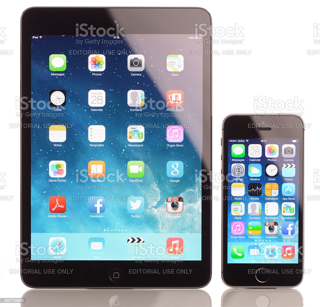 iPhone 5s and iPad Mini on white background stock photo