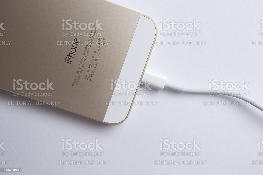 Iphone 5s gold and cable royalty-free stock photo